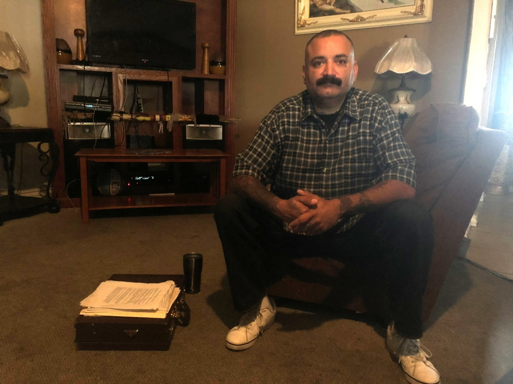 Manuel Barragan, 42, at his home in Hesperia, is a survivor of clergy abuse and was part of a class-action suit against the Catholic Church.