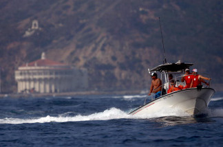 Spectators riding in chase boats watch their respective teams compete during the Catalina Crossing on September 03, 2008 just outside Avalon Harbor in Catalina Island, California