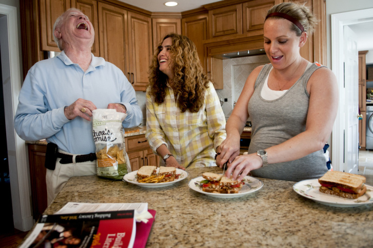Fabiola Morales jokes with her father-in-law, Robert F. Costello III, a retired financial adviser, while preparing lunch in the family's kitchen. Kelly Costello's dream is to be able to sponsor Morales and feel