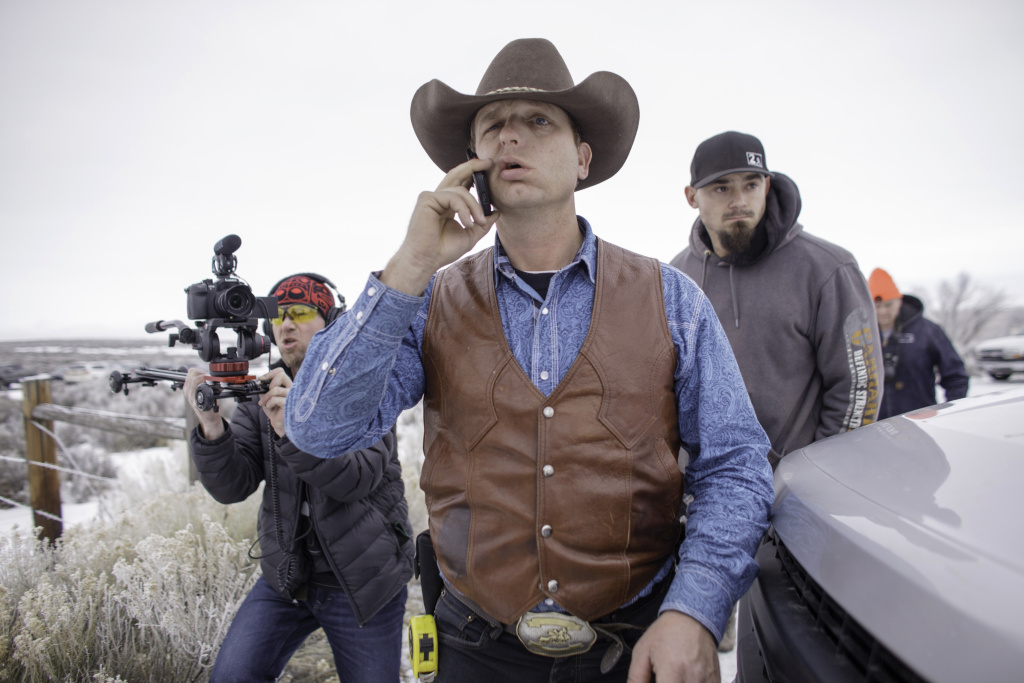 Ryan Bundy speaks on his phone at the occupied Malheur National Wildlife Refuge on the sixth day of the occupation of the federal building in Burns, Oregon on January 7, 2016.
