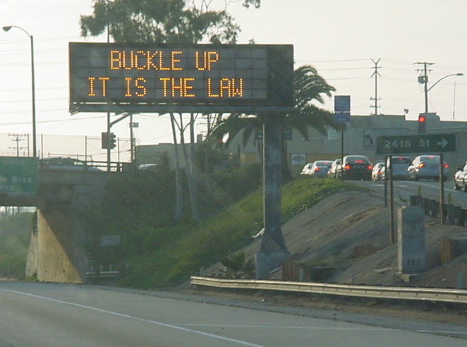 Buckle Up road sign