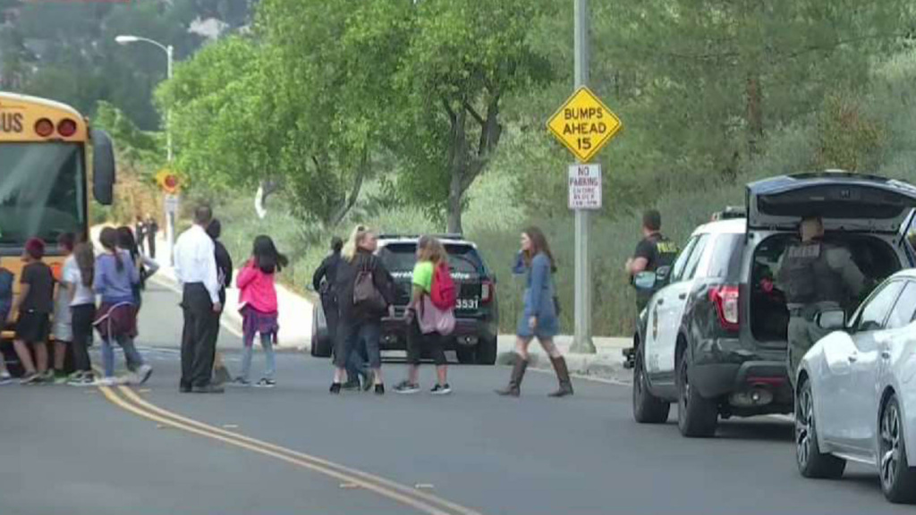 Students are escorted off campus at Castle View Elementary School in Riverside on Tuesday, Oct. 31, 2017. A man held a 70-year-old teacher hostage in a barricaded classroom.