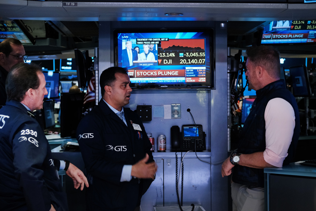 Traders work on the floor of the New York Stock Exchange (NYSE) on March 16, 2020 in New York City.