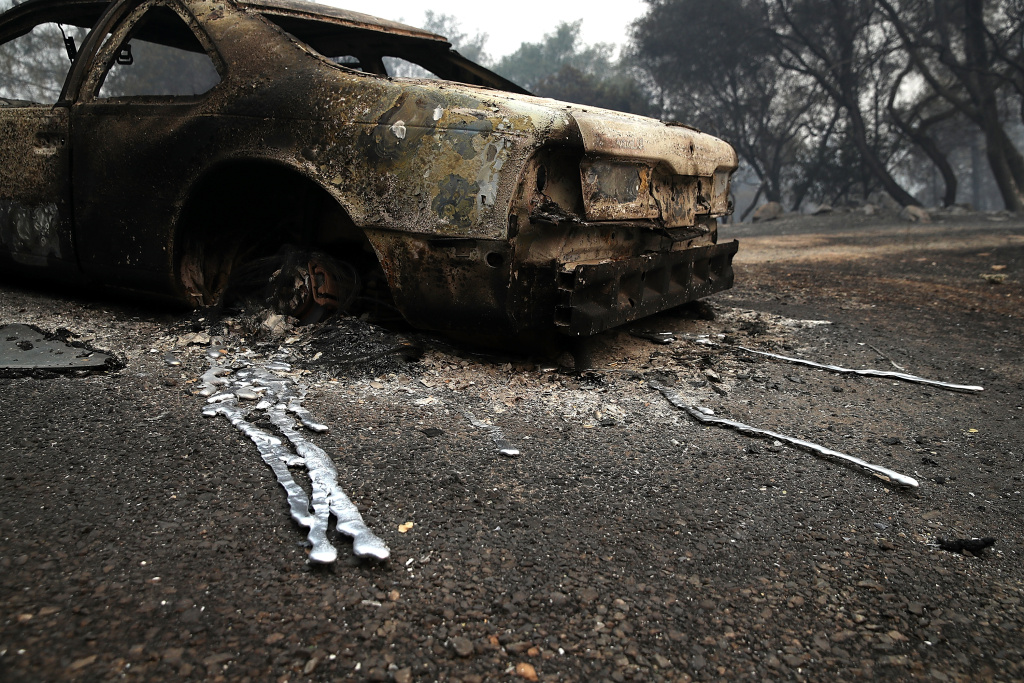 MARIPOSA, CA - JULY 19:  A burned out car sits next to a home that was destroyed by the Detwiler Fire on July 19, 2017 in Mariposa, California. More than 1,400 firefighters are battling the Detwiler Fire that has burned more than 45,000 acres, forced hundreds to evacuate and destroyed at least 8 structures. The fire is 7 percent contained.  (Photo by Justin Sullivan/Getty Images)