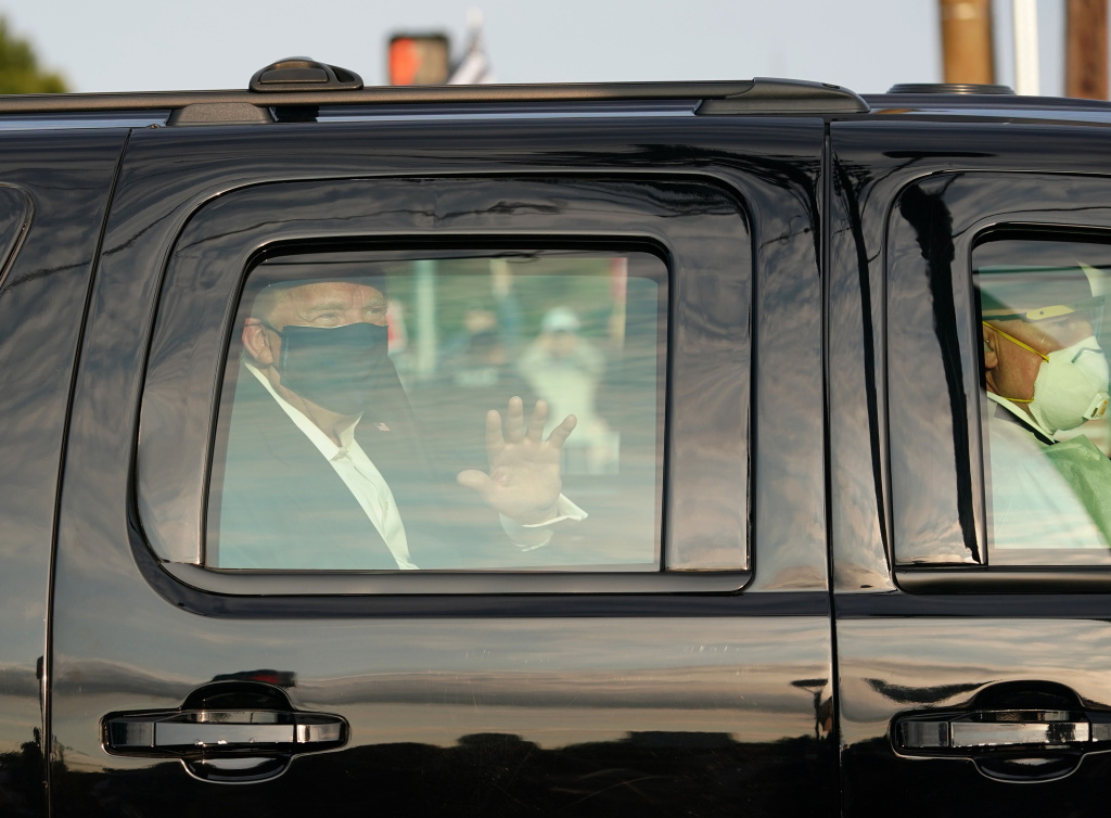 Despite public health recommendations that people infected with the coronavirus isolate themselves to prevent further transmission, President Trump rode with Secret Service agents past his supporters outside Walter Reed National Military Medical Center on Sunday.