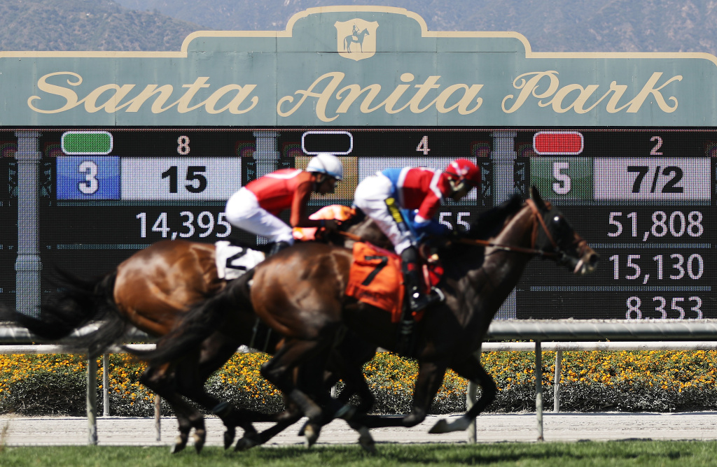 Race horses run on the final day of the winter/spring horse racing season at Santa Anita Park on June 23, 2019 in Arcadia, California.