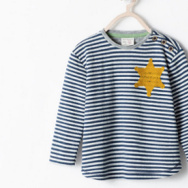 A kids shirt that was for sale on Zara.com.