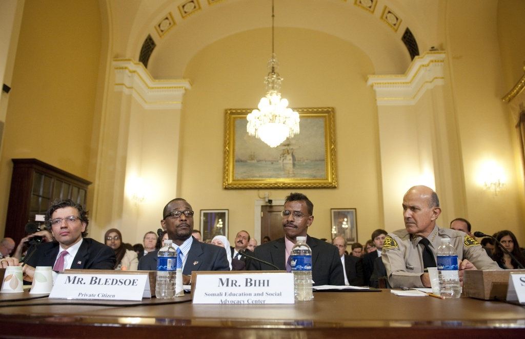 Dr. M. Zuhdi Jasser (L), president and founder of the American Islamic Forum for Democracy, Melvin Bledsoe (2nd L), Abdirizak Bihi (2nd R), director of the Somali Education and Social Advocacy Center, and Leroy Baca (R), Sheriff of Los Angeles County, testify before the Committee on Homeland Security holds the first in a series of hearings on radicalization in the American Muslim community, on Capitol Hill in Washington, DC, March 10, 2011.