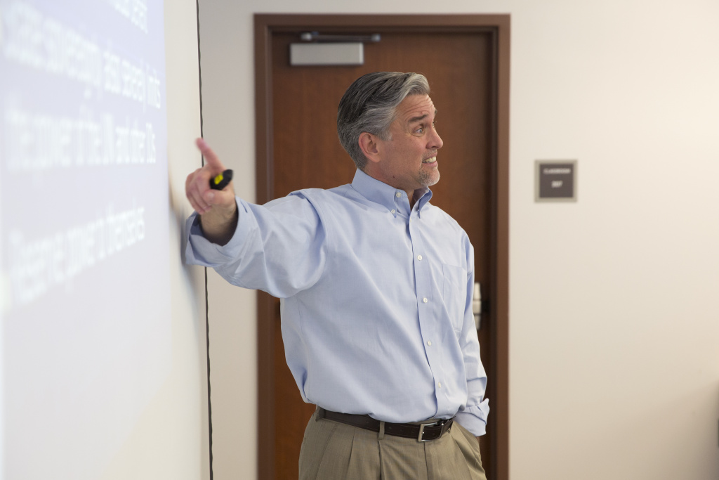 Professor David Andrus, chair of the department of political science at College of the Canyons in Santa Clarita, California, teaches his class to think critically about the elections.
