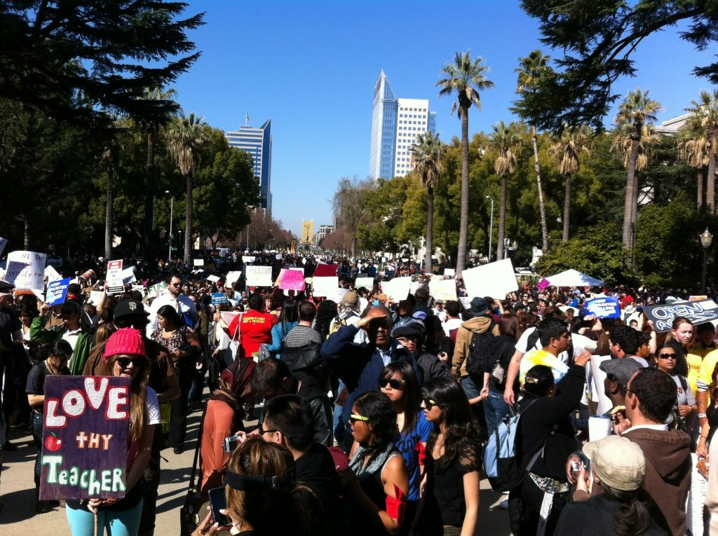 Thousands march earlier in the day on the state Capitol. Only a few hundred protesters remain.