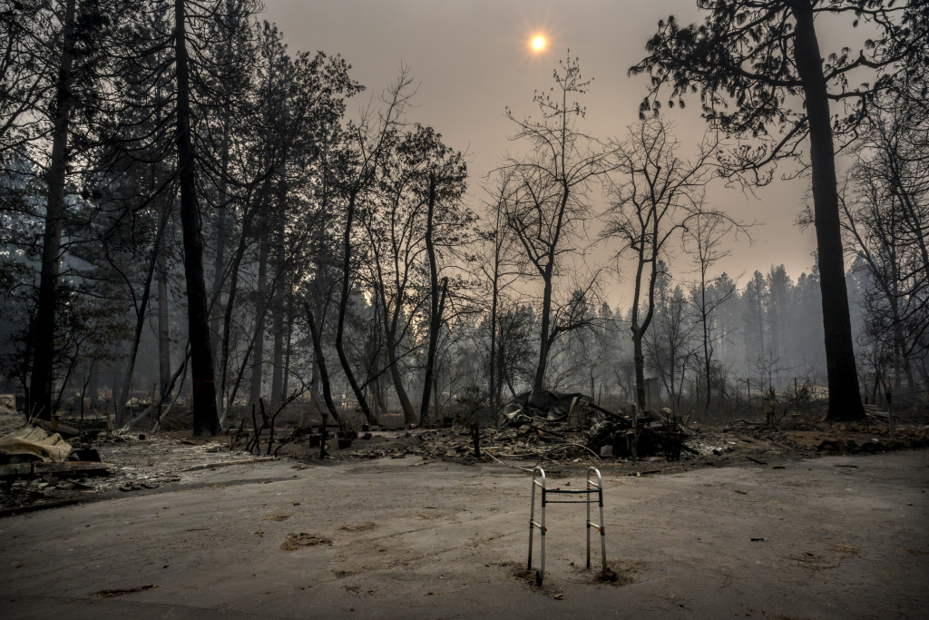 A walker remains abandoned on a cul-de-sac where most everything was destroyed inside the Pine Springs Mobile home park on Thursday Nov. 15, 2018 in Paradise, Calif. Many who perished in the tornado of fire were elderly. The Camp Fire's death toll is 88, while 158 remain missing, the Butte County Sheriff said in a tweet Tuesday night. It's the deadliest fire in California history.