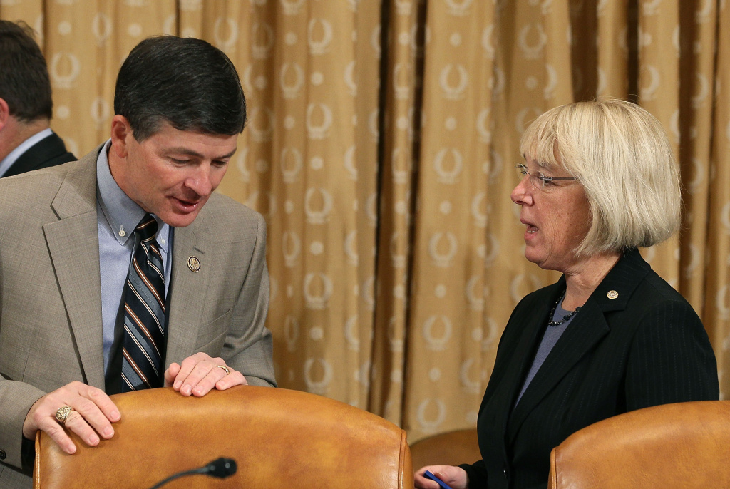 Co-chairman, Rep. Jeb Hensarling (R-TX)(L), talks with Sen. Patty Murray (D-WA)(R), during a Joint Deficit Reduction Committee hearing on Capitol Hill, on November 1, 2011 in Washington, DC. The special Joint Committee is tasked with finding $1.5 trillion in deficit reduction by Thanksgiving.