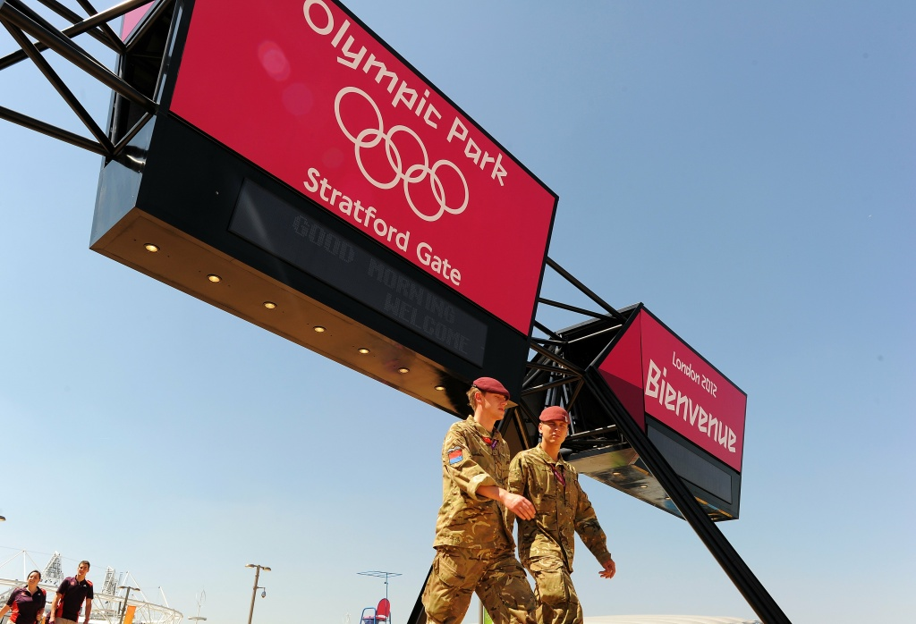 Soldiers walk to their posts at the Olympic Stadium in London on July 24, 2012, three days before the start of the London 2012 Olympic Games.