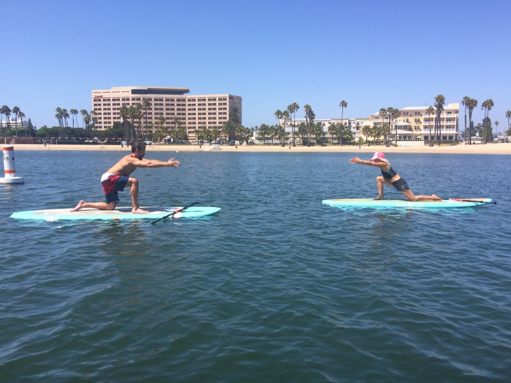 A Martinez learns to do yoga on a paddle board from YOGAqua founder Sarah Tiefenthaler.