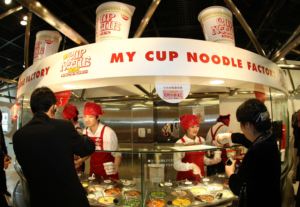 Visitors order their own cup noodle at the Instant Ramen Museum on April 8, 2008 in Osaka, Japan. It has been fifty years since Momofuku Ando, founder of Nissin Food Products Co., Ltd. first invented instant noodle