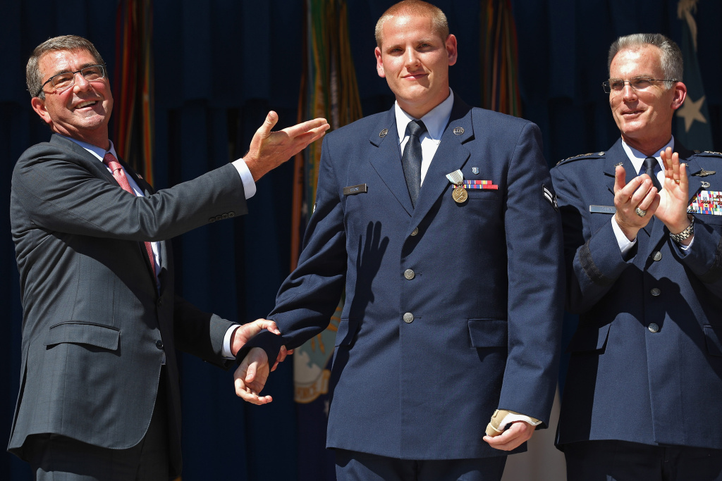 U.S. Air Force Airman 1st Class Spencer Stone  (C) is congratulated by U.S. Defense Secretary Ashton Carter (L) and Vice Chairman of the Joint Chiefs of Staff Gen. Paul Selva during an awards ceremony for Stone and two other men who helped stop a gunman on a Paris-bound train last month at the Pentagon in this September 17, 2015 file photo. An Air Force spokesman said Thursday, October 8, 2015, that details are sketchy but that Stone is being treated in a hospital in the Sacramento area after being stabbed.