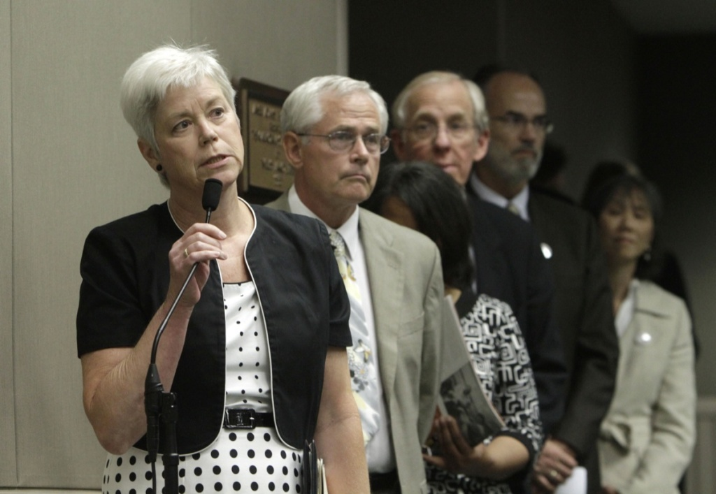 File: Amanda Wilcox, left, accompanied by her husband Nick Wilcox, second from left, whose daughter, Laura, was killed in a 2001 Nevada County shooting spree, joined others in calling on lawmakers to approve a bill aimed at abolishing capital punishment, at a hearing of the Assembly Public Safety Committee at the Capitol in Sacramento, Calif., Thursday, July 7, 2011.