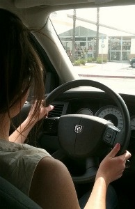 A teenager driving.