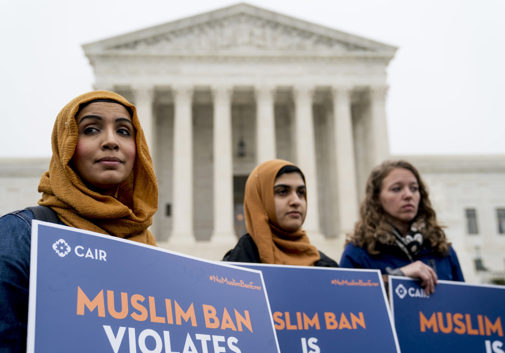 Zainab Chaudry, from left, Zainab Arain and Megan Fair with the Council on American-Islamic Relations, stand outside of the Supreme Court for an anti-Trump travel ban rally before oral arguments.