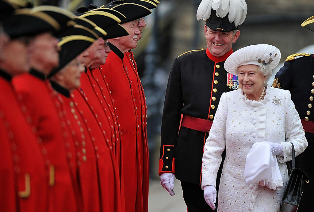 Britain's Queen Elizabeth II, right, arrives at Chelsea Pier in London, before boarding the royal barge to participate in the Diamond Jubilee River Pageant, Sunday, June 3, 2012.