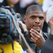 St. Louis Rams draft pick Michael Sam watches pregame festivities before the start of the South Dakota State-Missouri NCAA college football game on Saturday, in Columbia, Mo. Sam, the first openly gay player drafted by an NFL team, was released by the St.