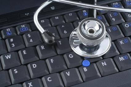 stethoscope lying on keyboard of a laptop