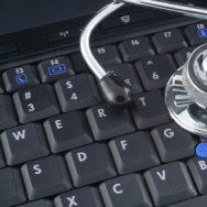 stethoscope lying on keyboard of a laptop