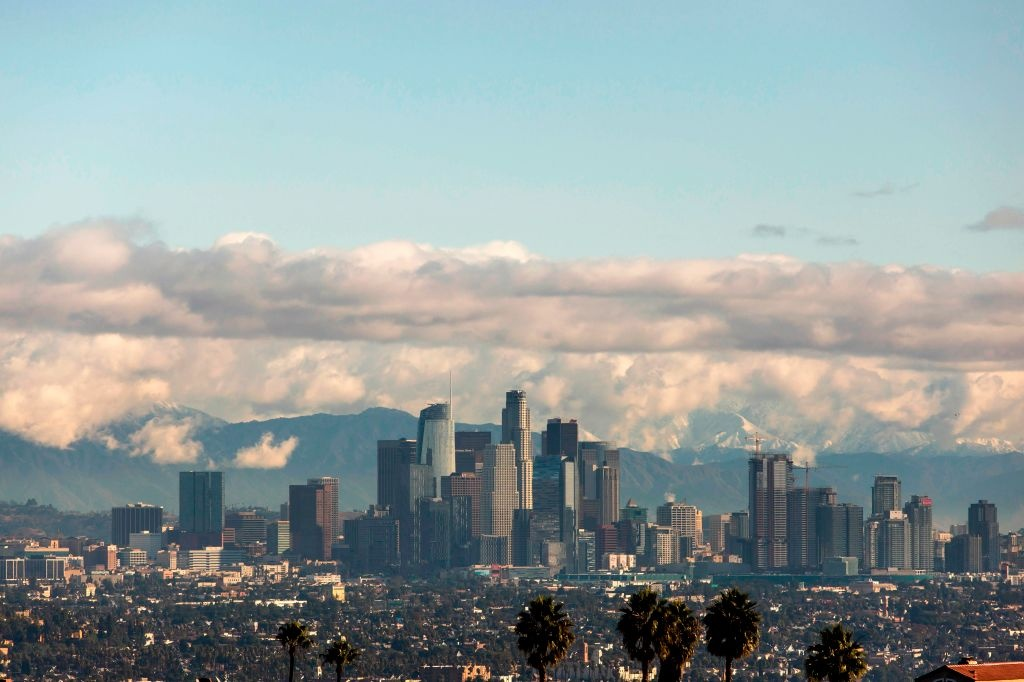 A view of the downtown Los Angeles skyline with the snow-covered San Gabriel Mountains in the background on November 29, 2019 in Los Angeles, California.