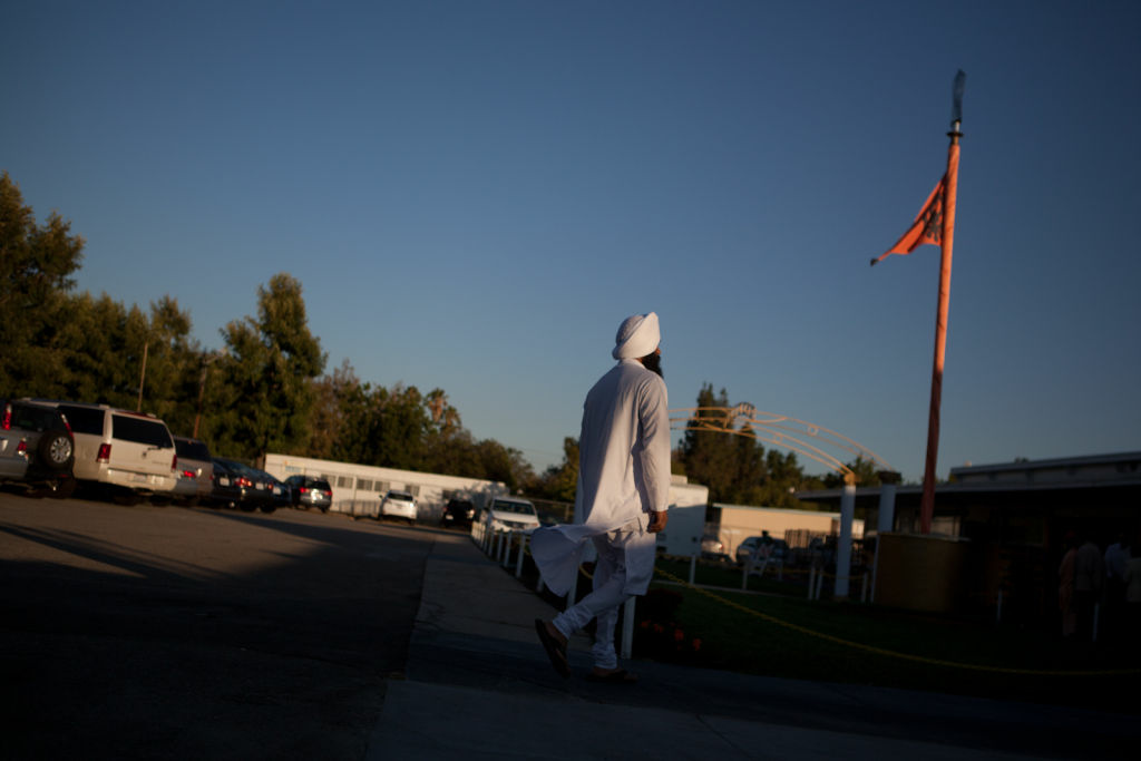 A Sikh man enters the gurdwara at the Khalsa Care Foundation on Monday, August 6.