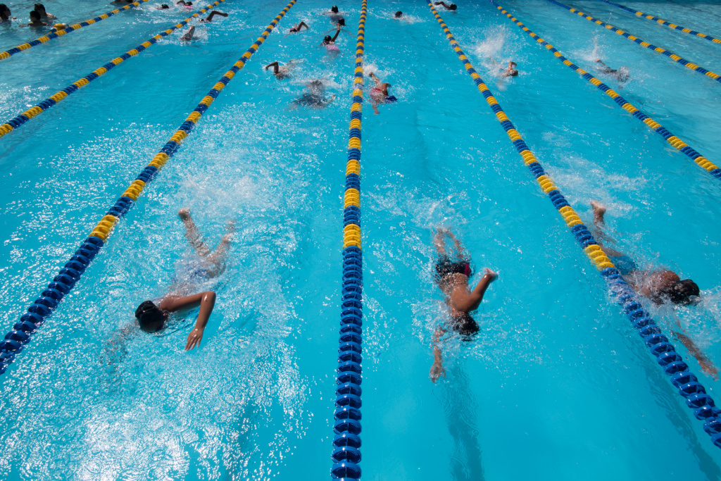 In this file photo, kids cool off at the Glassell Park Pool in June 2013. A program sponsored by the city of L.A. and Kaiser Permanente that kicked off Monday provides free swimming lessons to low-income children and adults.