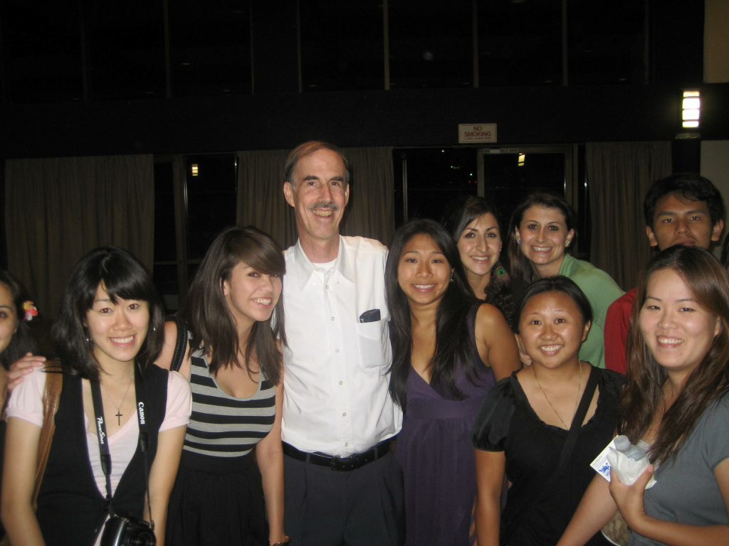 David Meyerhof surrounded by former students at the reunion.