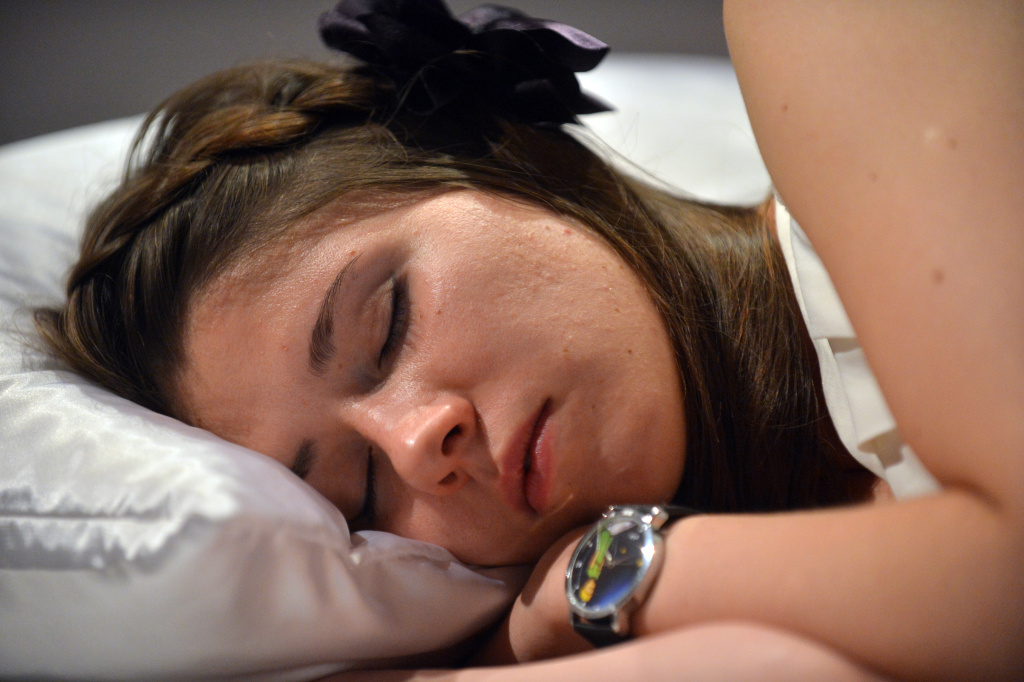 A woman sleeps on September 5, 2012 during a performance at Ukraine's National Art Museum in Kiev.