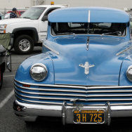 A blue Chrysler is on display at Long Be