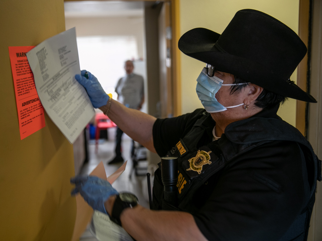 A constable posts an eviction order for nonpayment of rent in October in Phoenix. The CDC is extending an order aimed at preventing evictions.