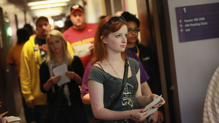 Students wait in line to vote last Friday on the campus of the University of Northern Iowa in Cedar Falls, a day after the swing state began in-person early voting.