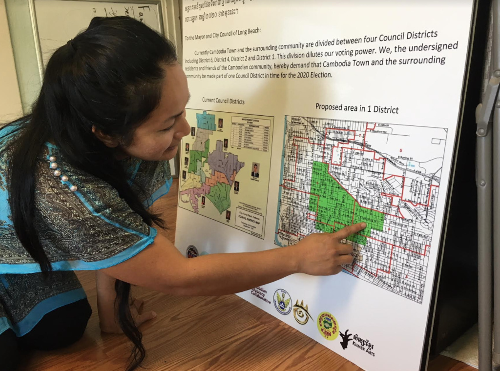 Lara Som, who directs the MAYE Center in Long Beach, points to a map of a proposed City Council district that would encompass the Cambodia Town neighborhood and the surrounding area.