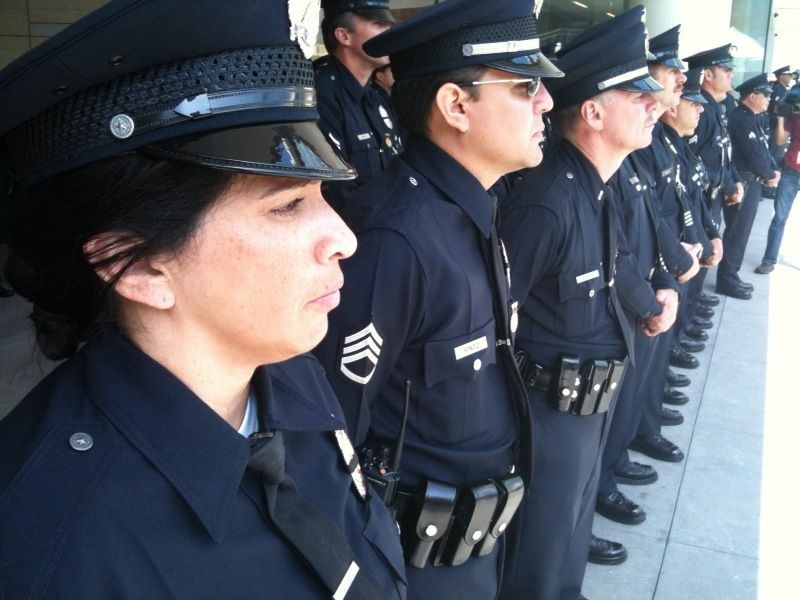 LAPD officers line up to honor fellow cops who died in the line of duty during the department's annual memorial service for fallen officers.
