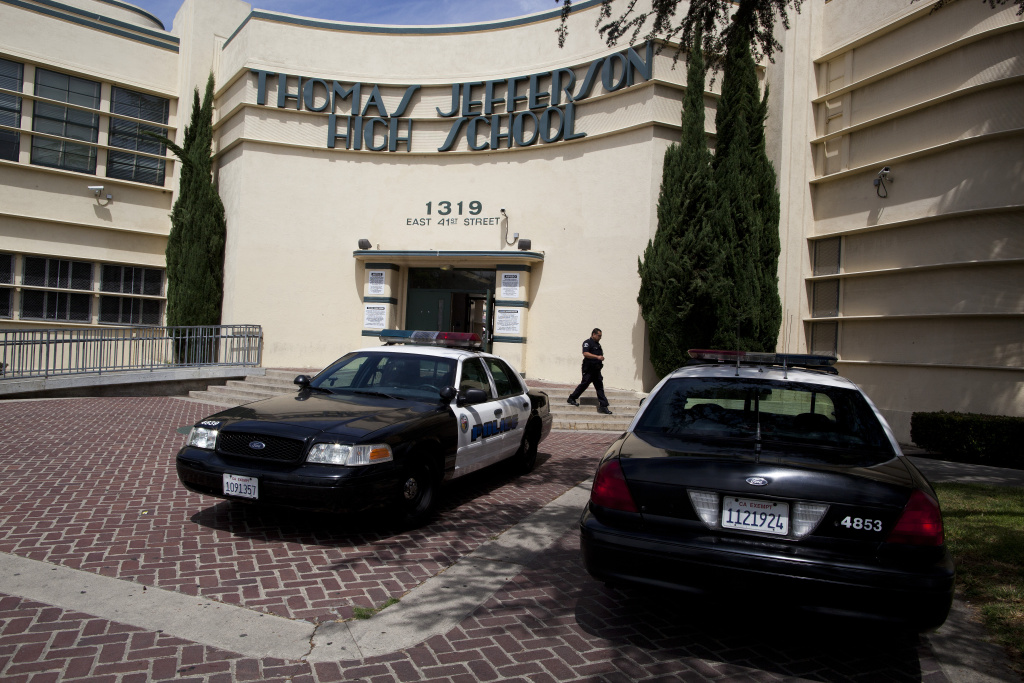 File: Los Angeles Police cruisers are parked outside of Jefferson High School to keep an eye on a student protest against a district-wide scheduling system that has kept them out of the classes they need to graduate.