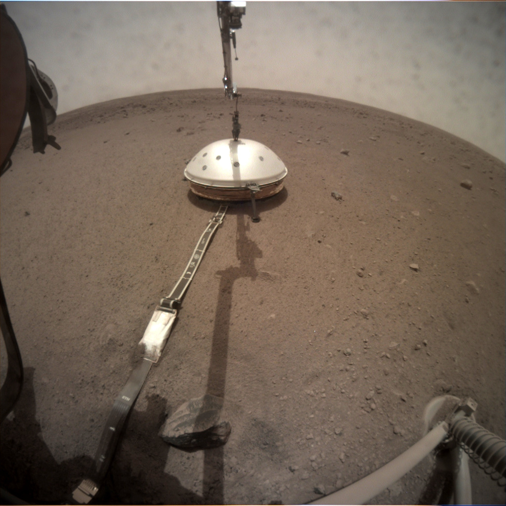 InSight's seismometer measures mars quakes from beneath a wind and thermal shield.