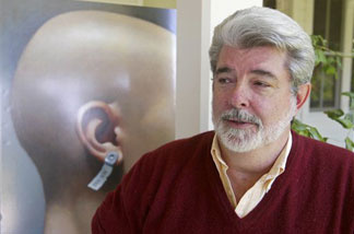 Filmmaker George Lucas, pictured at his Skywalker Ranch in Nicasio, Calif., Aug. 3, 2004, stands beside a poster of his first film,