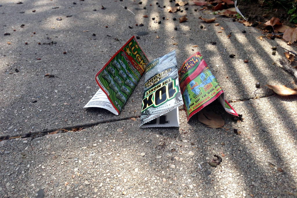 Three California Lottery Scratchers tickets, littered on the ground in Los Angeles.