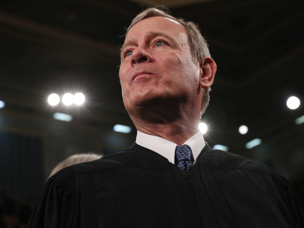 Chief Justice of the United States John Roberts awaits the arrival of President Donald Trump in the House of Representatives to deliver the State of the Union address in February. Roberts spent one night in the hospital in June after injuring his forehead in a fall.