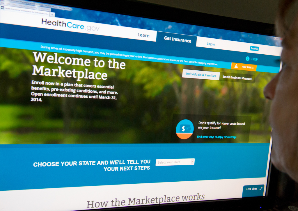 This December 2, 2013 photo shows a woman reading the HealthCare.gov insurance marketplace internet site in Washington, DC.