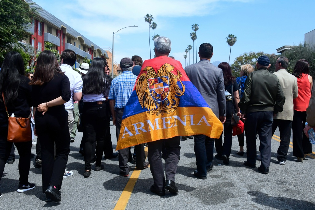 Armenian-Americans march in protest through the Little Armenia neighborhood of Hollywood, California on April 24, 2018 demanding recognition by Turkey on the 103rd anniversary of the 1915 Armenian genocide, which Turkey insists did not happen. (Photo by FREDERIC J. BROWN / AFP)        (Photo credit should read FREDERIC J. BROWN/AFP/Getty Images)