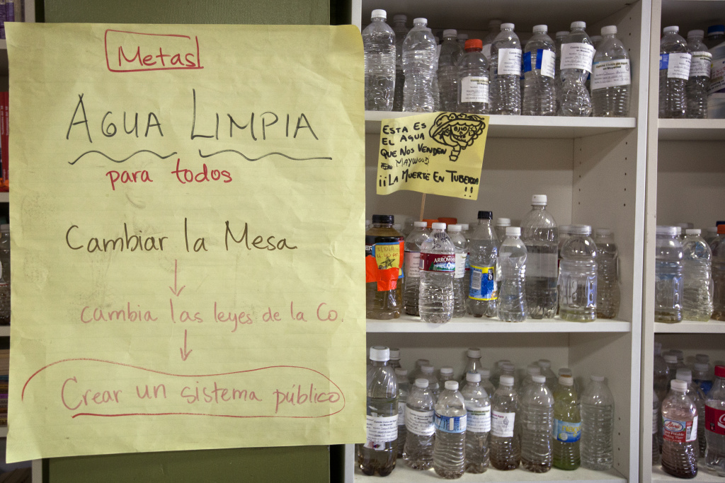 A Maywood community group, Union de Vecinos, stores bottles of tap water collected by residents over the years.