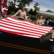 Boy Scouts carry an American Flag in the annual Memorial Day Parade on May 26, 2014 in Fairfield, Connecticut.