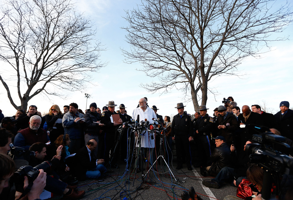 Connecticut Chief Medical Examiner H. Wayne Carver II talks to the media and answers questions about the elementary school shooting during a press conference at Treadwell Memorial Park on December 15, 2012 in Newtown, Connecticut.