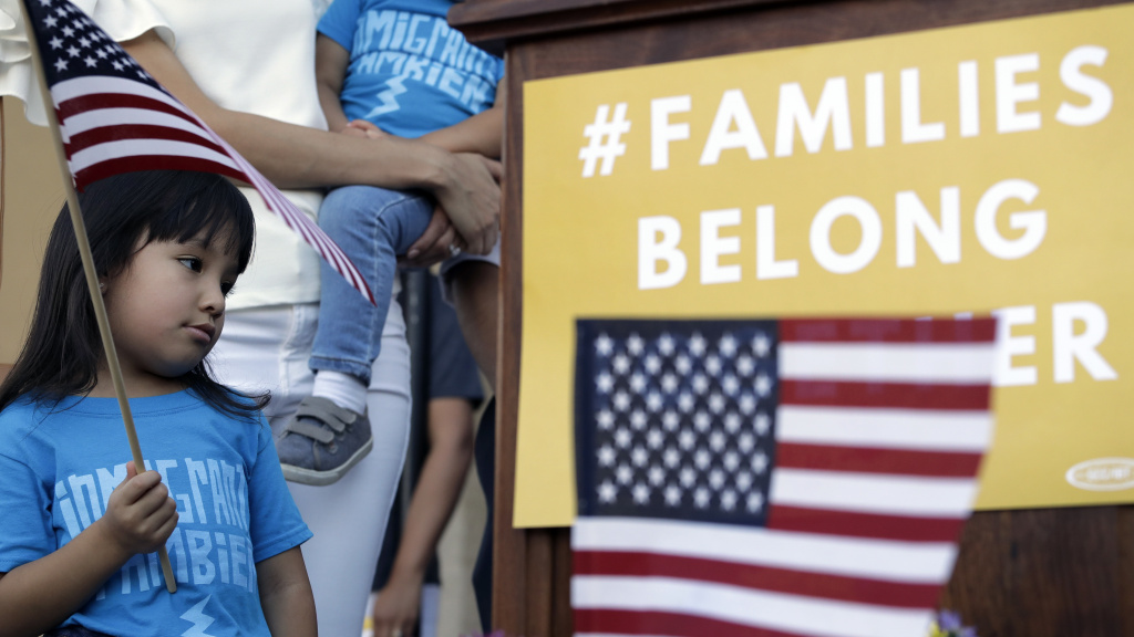 Andrea Elena Castro, daughter of Rep. Joaquin Castro (D-Texas), holds a U.S. flag during a Rally For Our Children event on May 31 to protest the