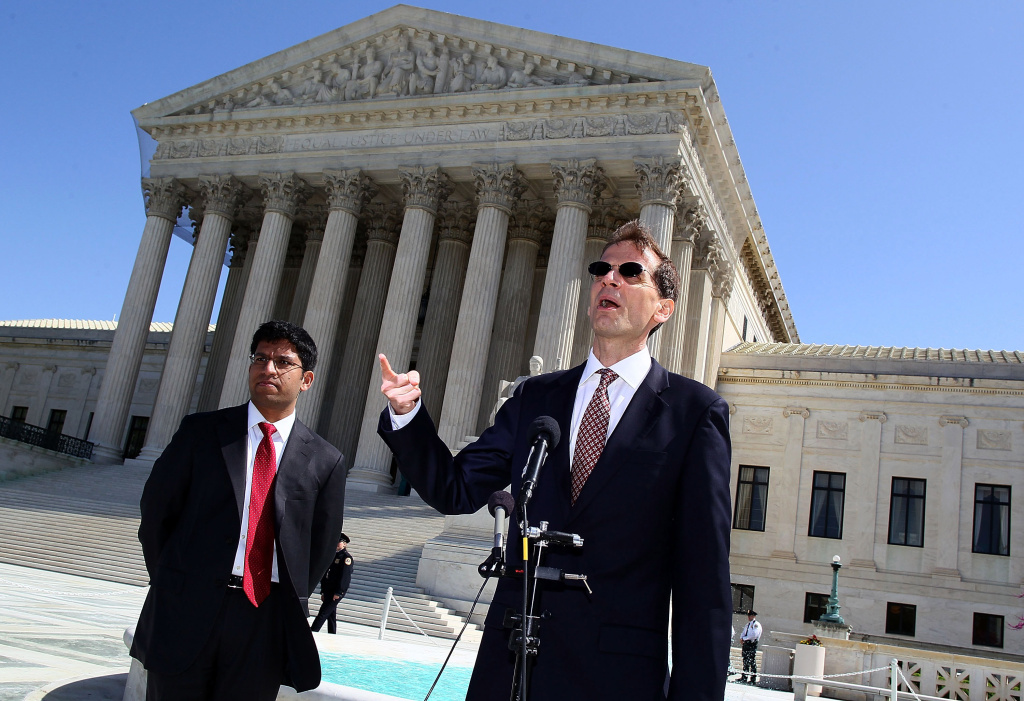 Attorney for the Solicitor Generals Office (R) speaks to the media after attending a hearing at the U.S. Supreme Court Building on March 26, 2012 in Washington, DC.