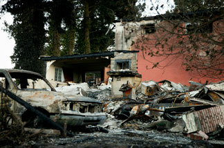 Destruction is seen in the aftermath of a gas line explosion September 10, 2010 in San Bruno, California. The explosion rocked a neighborhood near San Francisco International Airport, destroying 37 homes, killing at least 4 people, and injuring at least 50.